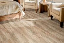 FLOOR: Vinyl / Nothing brings style, durability and comfort together quite like today's vinyl. And talk about affordability. That flooring in your kitchen may look like expensive hardwood. But it's vinyl. Yes, vinyl allows you to incorporate the look and feel of tile, hardwood or stone into your décor without the cost. / by Carpet One