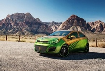 Aquaman-inspired Rio 5-door / Given the Kia Rio's reputation as one of the most eco-friendly vehicles on the road today – 85-percent of Rio's materials are recyclable at the end of its lifespan – the subcompact provided a natural automotive alter-ego for Aquaman, symbolizing his role as protector of the environment, both land and sea. The Aquaman-inspired Rio 5-door also received the West Coast Customs treatment with special gold, green and orange exterior paint and a body kit featuring custom-fabricated fins.