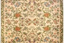 Needlework Rugs / Antique needlework rugs are carpets in which yarn is stitched onto a cloth foundation, mostly using slanting stitches. The rugs, which are also referred to as embroidered rugs, were widely produced in Aubusson prior to World War I.