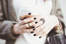 {nails} / 2.  a hard covering on the upper surface of the tip of the finger and toe in humans and other primates.