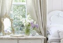 Shabby Chic / Shabby chic is a glamorous mix of antique pieces decor and soft, muted colors.  Lace, ruffles, and floral patterns are all common attributes to shabby chic style.