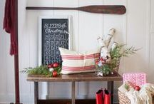 """GET THE LOOK: HOLIDAY HOME TOUR 2015 / From the tiniest of details like the rope knotted place card holders, to the most obvious of design elements like the classic woody speedboat in the driveway, the Fabulous Forties home showcases coastal Christmas magic. With spools of rope, nautical flags and bright colors, """"Merry-Time Christmas"""" is the embodiment of all-American holiday cheer."""