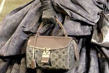 LOUIS VUITTON / Did you know? Louis Vuitton was a French entrepreneur and designer whose name has become iconic in the fashion world. He became a very successful box and trunk maker catering to royalty and the Parisian elite in the mid 1800's.  After his death, under his son George,who created the company's famous LV monogram, and future generations of Vuittons, the Louis Vuitton brand would grow into the world-renowned luxury leather and lifestyle brand it remains today.