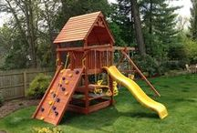 Some of Our Installations / See how our playsets look in real backyards. These are some of our happy customers' swingsets (and trampolines). We can guide each family to help design a custom playset or choose a pre-designed package that fits their needs. Our skilled, experienced, friendly install crew will help guide with optimal placement and positioning of your playset in your backyard. (Please don't mind the amateur photography!)
