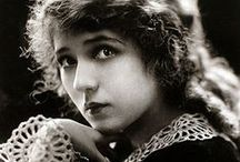 "Mary / ""America's Sweetheart"". Pickford was also a savvy businesswoman and the first female movie mogul.  She was the first female actor to earn more than a million dollars per year. Total rags to riches story. She fought her way from a starving child to being the biggest name in film. Don't let the curls and baby face fool you. This women was bad ass!"