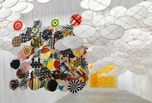 Jacob Hashimoto / Hashimoto works using traditional kite-making techniques on a grand scale from his studio in Brooklyn. Small kite-like elements are handmade from paper and adhered onto a bamboo frame. Kites cascade from brackets on ceilings, walls and floors to create enormous, undulating, sculptural clouds.