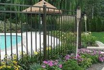 Aluminum Fences / An aluminum fence costs less than a traditional wrought iron fence – yet lasts much longer and maintains the same traditional beauty.  Aluminum fences are becoming some of our most popular residential fencing products.