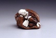 Netsuke and Inro / Japanese artists cleverly invented the miniature sculptures known as netsuke to serve a very practical function. Traditional Japanese garments had no pockets. Men who wore them needed a place to keep personal belongings such as pipes, tobacco, money, seals, or medicines.  The solution was to place such objects in containers, called sagemono or inro, hung by cords from the robes' sash. the fastener that secured its cord at the top of the sash was a carved, button-like toggle called a netsuke.