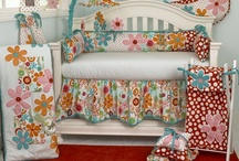 Lizzie / The Lizzie four piece baby bedding set has lots of color in a bright cotton motif.  Large appliquéd daisies on a patchwork of big dot red, small red dot and a fancy contemporary floral.  Accents in bright turquoise four sectioned bumper, patch worked front and back with large floral appliqué.  Sculptured dust ruffle with turquoise trim.  Soft dot sheet 100%, 200 thread count cotton.  http://www.cottontaledesigns.com/collections/lizzie.html