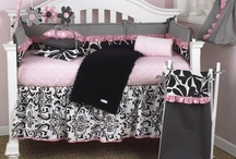 Girly / What could be cuter than this adorable baby bedding set? Sweet, bright pink dot trim with contemporary floral and furry curly Q fleece coverlet in black.  The bumper is a combination of big floral black pin dot and bias stripe black & white trimmed in a bright pink ruffle.  This is a smashing nursery for your baby girl.  http://www.cottontaledesigns.com/collections/girly.html