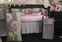 Poppy / Poppy is an all-cotton baby bedding set with contemporary poppy appliqué. Fun patchwork poppies appliquéd on a light weight comforter, reverse in big dot pink.  Four sectioned patched bumper, big dot pink sheet and tailored black and white stripe crib skirt combine to make this current and cute. This collection is perfect for your little girl. http://www.cottontaledesigns.com/collections/poppy.html