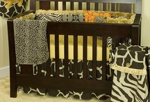Sumba /  All Cotton Tale baby bedding sets are made using the finest quality materials and are uniquely designed to create an elegant and sophisticated nursery. Sumba is a combination of fun animal prints and African art, all of 100% cotton duck. 4 sectioned bumper with fringe trim and patch work front and back. 250 thread count cotton sheet in gold pebble print. Giraffe print bed skirt and soft, reversible cheetah coverlet. Neutral pattern. http://www.cottontaledesigns.com/collections/sumba.html