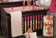 Sundance / The Sundance Baby Bedding Collection is a combination of beautiful ikat fabrics in hot pink, tan, and orange.  Bright pink with orange dot accents on trims and sheet.  http://www.cottontaledesigns.com/collections/sundance.html