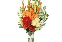 Warm Colors Funeral Inspiration / Here are a few warm-colored funeral stationery themes and floral arrangements to give you inspiration.