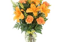 Orange Funeral Inspiration / Here are a few orange-colored funeral stationery themes and floral arrangements to give you inspiration.