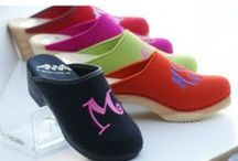 Monogrammed Clogs / The Pink Monogram began making our monogrammed clogs in 2001 and still continue to manufacture a comfortable shoe. Unique because we can personalize your color suede, leather or wool and add a monogram for some fancy feet!