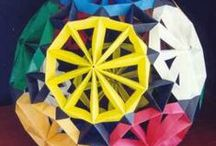 """Origami / Origami, (折り紙?, from ori meaning """"folding"""", and kami meaning """"paper""""; is the traditional Japanese art of paper folding, which started in the 17th century AD at the latest and was popularized outside of Japan in the mid-1900s. The goal of this art is to transform a flat sheet of paper into a finished sculpture through folding and sculpting techniques, and as such the use of cuts or glue are not considered to be origami. Paper cutting and gluing is usually considered kirigami."""