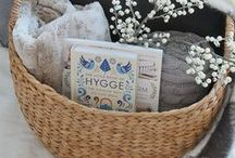 "Hygge Lifestyle / Pronounced ""hoo-gah"". The Danish word for a mood of coziness and togetherness like the feeling of a warm fireplace, wool socks, sipping tea in a hot bath and the smell of a flickering candle nearby. Environments that foster community and comfort in your home and with your decor."