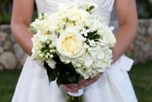 white  wedding / all white flowers with glass containers in eclectic shapes and sizes