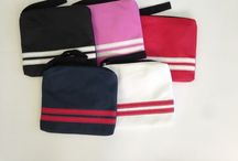 """Zipper bags / Leatherette zip bags with hand handle and back zipper pocket. 9"""" x 8.5""""  www.jupitersports.net / by Heather Bryan"""