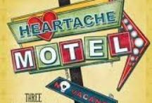 HEARTACHE MOTEL / HEARTACHE MOTEL by Terri L. Austin, Larissa Reinhart, LynDee Walker.  Elvis has left the building, but he's forever memorialized at the Heartache Motel. Filled with drag queens, Rock-a-Hula cocktails, and a vibrating velveteen bed, these three novellas tell the tales of three amateur sleuths who spend their holidays at the King's beloved home / by Henery Press