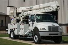 Material Handlers / Bucket Trucks for sale with material handlers at Utility Fleet!
