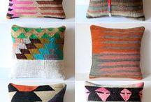 Rugs, pillows, wallpaper, & light fixtures
