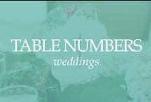 TABLE NUMBERS / Gourmet Invitations collection of table markers, table numbers and table names for events. table number, table name, table marker, numbers for table, wedding table numbers, unique table numbers, picture table numbers, framed table numbers, table resolutions, table saying, table numbers with wording, table number holders, metal table numbers, wood table numbers