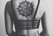 Tattoos & Peircings / tattoos are a way to express yourself and I love them  / by Regan Meredith