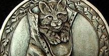 """Hobo Nickels / During the Great Depression, it was the pastime of many """"hobos"""" to transform nickels into other works of art, creating deep miniature bas relief designs. The practice started in the 1800's and continues today."""