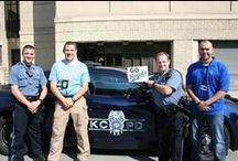 Officers in the Community / Kansas City Missouri Police Department Officers helping others in the community.  / by Kansas City Missouri Police Department
