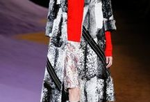 Whats Black and White and Red all over?  2014 / The collections are architectural, assymetrical, alot of black white and red, and alot of fur!  Loving it all!