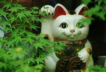 Style: Happy Cat Maneki Neko / The Japanese Maneki Neko / Happy Cats / Beckoning Cats are symbolic for prosperity. Who can resist the smiles on their faces?