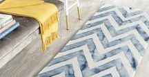 HOME -- Beach Rugs / When you're at the beach house, you want something soft under foot that will help absorb the sand.  Here are some of our favorite rugs to get the job done with style.