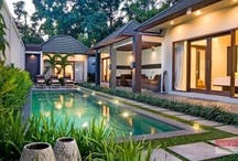 Villa Angel, Seminyak / Villa Angel consists of two buildings and a relaxation pavilion set within a compact walled garden planted with heliconia and palms. The single-storey contemporary villa presents three bedrooms with en-suite bathrooms, a 12 x 3 meter lap pool, an outdoor living space, a semi open-air living and dining room, a kitchen, and a relaxation pavilion.