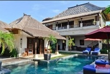 Villa Bima, Seminyak / Villa Bima is a three-bedroom villa arranged over two floors, with a private pool and lush greenery throughout. On the ground floor you'll find the fully equipped kitchen, living area and the two guesthouses. On the top floor is another spacious bedroom with en-suite semi-outdoor bathroom, a small office/bedroom with sofa bed.