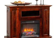 Amish Fireplaces / Stay warm this winter with an Amish electric fireplace. Enjoy snuggling next to our beautiful solid wood fireplace mantels with electric fireplaces inside.  The weather may be cold and snowy, but you can enjoy the warmth from your Amish made fireplace.