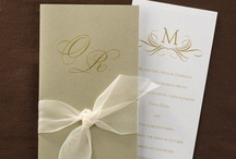 Gold Wedding Invitations / Wedding invitations featuring the color gold. Many styles of invitations for weddings that featuring gold borders, embossing, gold ribbon, gold hearts, invitations pockets and flowers. / by Wedding Bedazzle