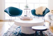 LIVING ROOMS / Comfortable, yet chic family rooms and dens. A lot of clean lines, turkish rugs, and styled vignettes. / by Modern Eve