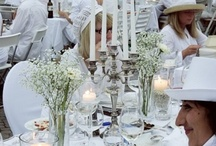 """Diner en Blanc / Le Diner en Blanc is a """"flashmob"""" pop-up style picnic where all guests dress in white form head to toe, bring their own three-course meal and white table settings, folding table, chairs and linens.  The tradition began more than 20 years ago in France and since then has spread to major cities around the globe.  Guest gather in small groups at pre-designated staging areas and no one knows the mystery location until the last moment.  Group leaders lead their groups to the diner location."""