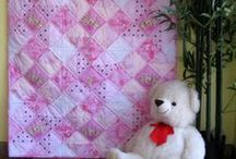 Baby Quilts for Girls / Handmade baby quilts for girls  / by Unique Baby Quilt Boutique