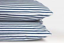 rugs, cushions + throws