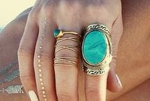 Jewelry / bling earrings, shining necklace, stunning rings.