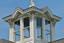 Cupolas & Weathervanes / Cupolas and weathervanes.  cu·po·la noun \ˈkyü-pə-lə, ÷-ˌlō\ : a rounded roof or part of a roof : a small structure that is built on top of a roof