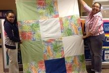 Staff making mission quilts / The churchwide staff is participating in the Lutheran World Relief 2013 Quilt Challenge.
