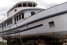 Hulls for conversion into a houseboat / On my website waterloft.nl i give a list of possible conversion projects into a houseboat.  / by waterloft.nl