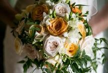 Our Weddings    Eastnor Castle Wedding / Kim & Paul married in August in the grand surroundings of Eastnor Castle. Candelabras adorned with peach and orange roses were used as table centrepieces, and the old coats of armour made fabulous backdrops for photographs