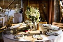 Our Weddings    Heron's Barn / Bare beams and concrete floors makes Heron's Farm barn the most rustic one we've styled to date. It was the perfect blank canvas for Ally & Jon to make the venue their own. We used white flowers throughout for a simple, yet breath taking effect.