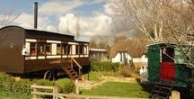 High Cross Camping Coach / Converted railway carriage for self contained holiday accommodation along with a Living Van providing sleeping for four. Located in the village of Netherbury in stunning West Dorset. See https://www.facebook.com/HighCrossHolidays for further details.