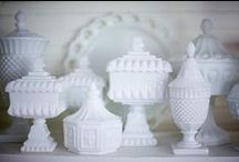 Milk glass / Milk glass originated around the 16th century in Venice, Italy. The glass of that time came in many colors. By the 19th century, glass makers referred to it as opaque glass. It was considered a high class, luxury item. The American Gilded Age of the 20th century held some of the best made milk glass ever. Determining the time era from which a piece might have come is quite difficult for the average collector, because not all pieces have identifying markings.  / by jrachelle